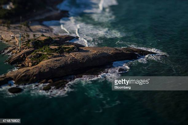 People walk on Arpoador rock in this photo taken with a tiltshift lens in Rio de Janeiro Brazil on Wednesday May 20 2015 Even with the real posting...