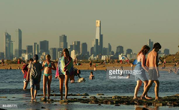 People walk on Brighton Beach as a heatwave hits Melbourne on January 27 2009 in Melbourne Australia The temperature today is estimated to hit 38...