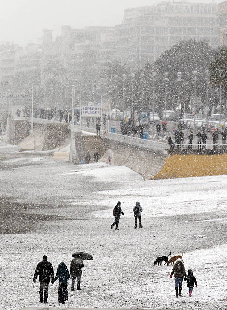 People Walk On Nice S Snow Covered Beach