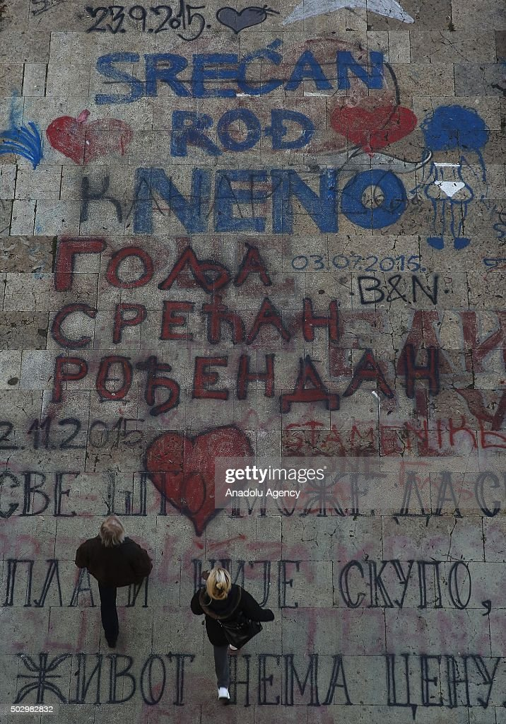 People walk on painted roads in Belgrade, Serbia on December 31, 2015.
