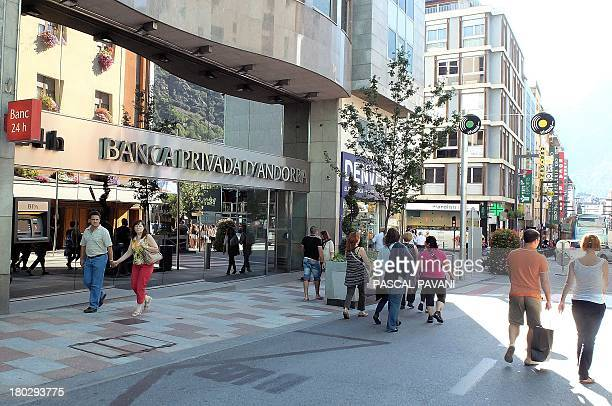 People walk on September 10 2013 past a branch of the Banca Privada d'Andorra in AndorralaViella in the principality of Andorra AFP PHOTO PASCAL...