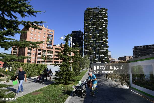 CORNU People walk on September 5 2017 in front of the architectural complex designed by Studio Boeri the Bosco Verticale in the Porta Nuova area in...
