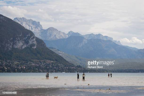 People walk on the Annecy Lake on October 6 2018 in Annecy France Lake Annecy has reached a low level due to this past summer's heatwave