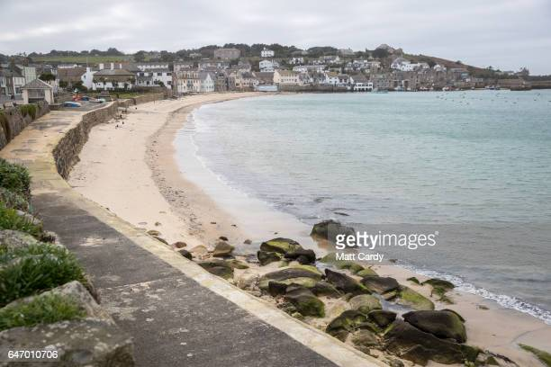 People walk on the beach in Hugh Town on St Mary's on the Isles of Scilly February 22 2017 in Cornwall England The temperate Isles of Scilly with a...