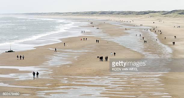 People walk on the beach in Scheveningen on December 26 a day after Christmas / AFP / ANP / Koen van Weel / Netherlands OUT