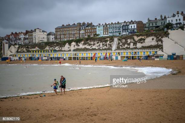 People walk on the beach on July 26 2017 in Broadstairs England Broadstairs is known as the 'jewel in Thanet's crown' and is a popular destination...