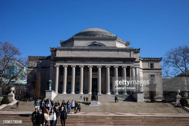 People walk on the Columbia University campus on March 9 2020 in New York City The university is canceling classes for two days after a faculty...