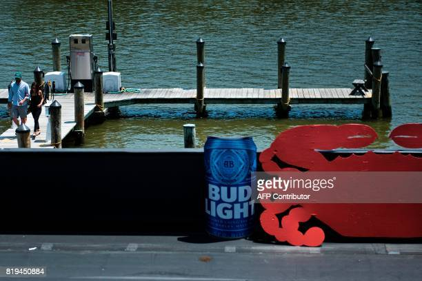 People walk on the dock after arriving to eat at Cantler's Riverside Inn June 28 2017 in Annapolis Maryland A unique multimillion dollar industry...