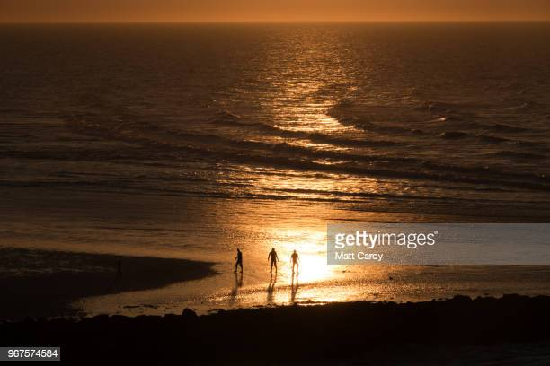 People walk on the Gold Beach at Ouistreham viewed from the deck of the ferry from Portsmouth to Caen as it travels to Normandy in France on June 3...