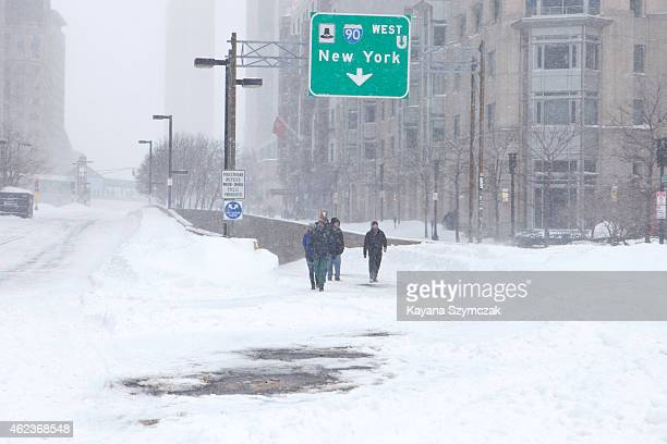 People walk on the highway ramp through the strong wind and snow in the Back Bay neighborhood during a blizzard on January 27 2015 in Boston...