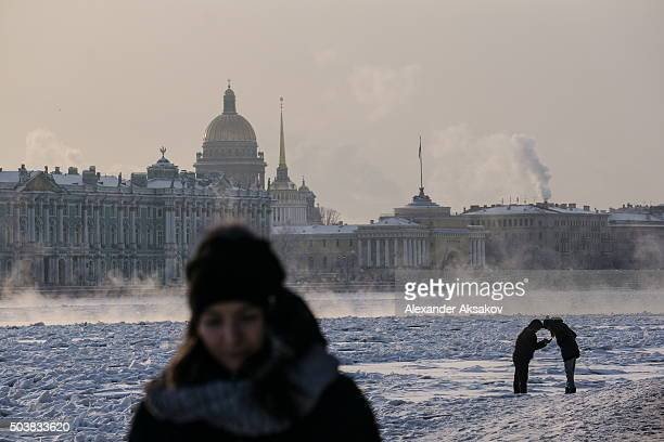 People walk on the ice of river Neva as Russia celebrates Christmas on January 7, 2016 in St. Petersburg, Russia. Russian Orthodox Christians...