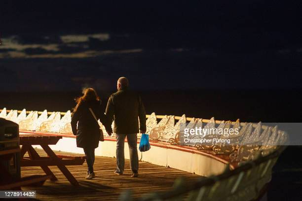 People walk on the near deserted Central Pier on October 06, 2020 in Blackpool, England. This year to help boost the tourism trade, which has been...