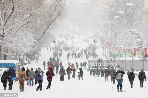 People walk on the snow along Calle de Segovia during heavy snowfall on January 09, 2021 in Madrid, Spain. Spain is on red alert for a second day due...