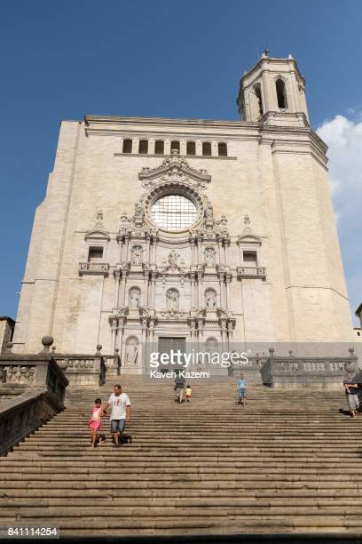 People walk on the stairs leading to Girona Cathedral also known as the Cathedral of Saint Mary on July 10 2017 in Girona Spain Girona is a city in...