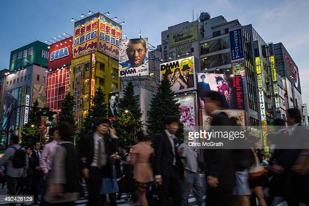People walk on the street in Akihabara Electric Town on May 19 2014 in Tokyo Japan Akihabara gained the nickname Akihabara Electric Town after World...