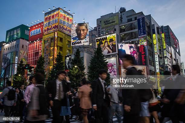 People walk on the street in Akihabara, Electric Town on May 19, 2014 in Tokyo, Japan. Akihabara gained the nickname Akihabara Electric Town after...