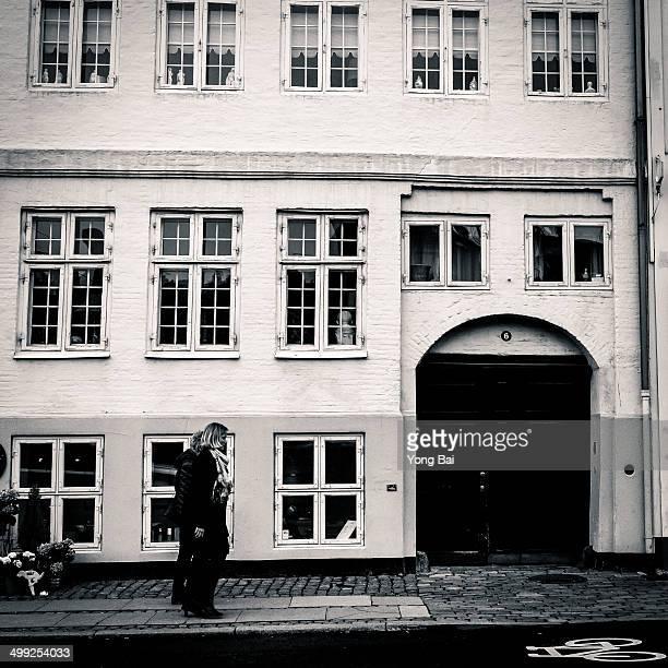 People walk on the street of Copenhagen.