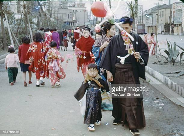 People walk on the street to make the 'Hatsumode' first visit to the shrine at Yasaka Jinja Shrine in January 1954 in Kokura Fukuoka Japan