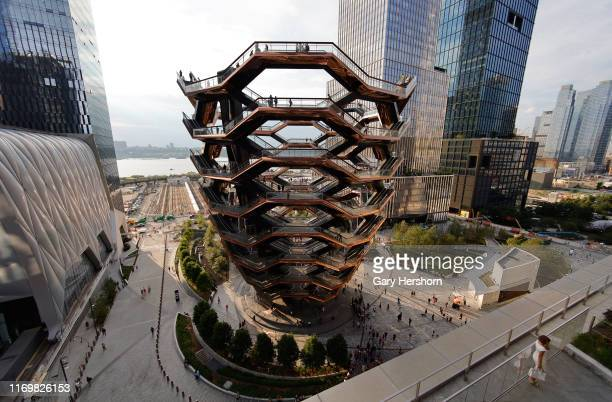 People walk on the Vessel at Hudson Yards on August 8, 2019 in New York City.