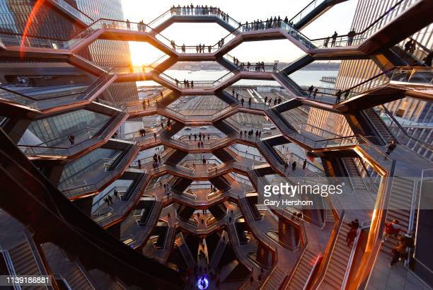 People walk on the Vessel at Hudson Yards on March 27 2019 in New York City