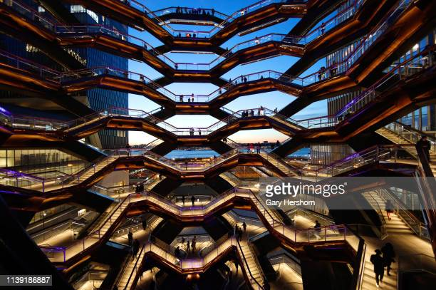 People walk on the Vessel at Hudson Yards on March 27, 2019 in New York City.