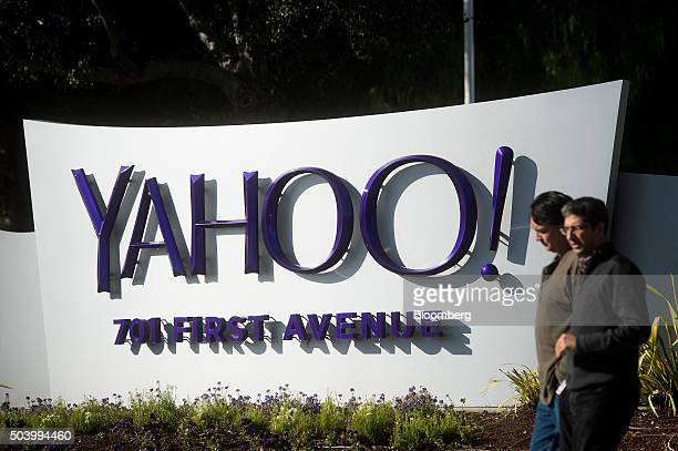 People walk on the Yahoo Inc headquarters corporate campus in Sunnyvale California US on Thursday Jan 7 2016 Yahoo Inc is planning to eliminate jobs...