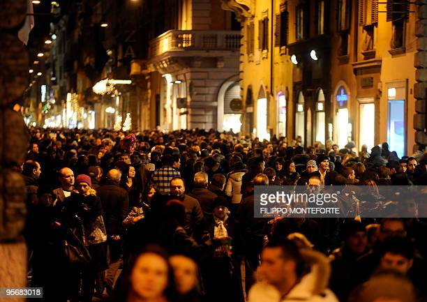 People walk on Via del Corso street one of central Rome's main shopping streets for the second day of sales on January 3 2010 Thousands of Roman and...
