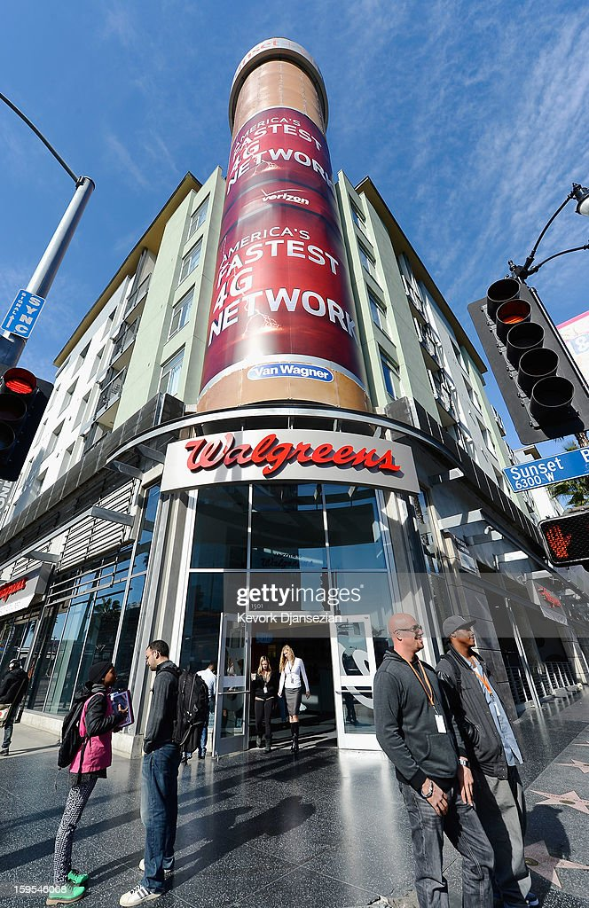 People walk out of a new Walgreens at the corner of Sunset and Vine on January 15, 2013 in Hollywood, California. The new 23,500-square-foot, drugstore, the company's 8,000th store and first West Coast flagship, includes high-end cosmetic, skinand hair care brands, a frozen yogurt station, a fresh sushi bar, a coffee and espresso bar, a juice and smoothie bar, a wine and spirits shop with a and a virtual bartender kiosk and a cigar humidor.