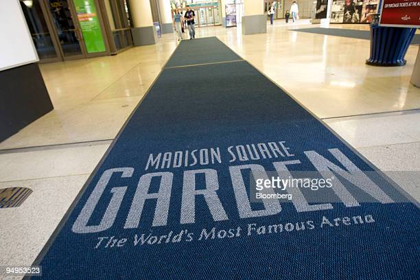 People walk out of the entrance to the Madison Square Garden arena in New York US on Friday May 8 2009 Cablevision Systems Corp the media company...