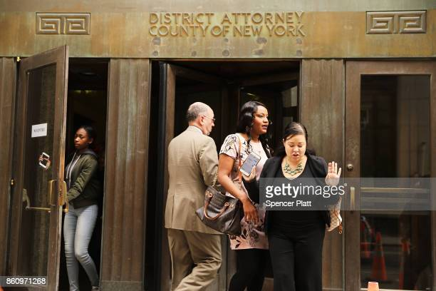People walk out of the Manhattan District Attorney's office on October 13 2017 in New York City Cyrus R Vance Jr the Manhattan district attorney has...