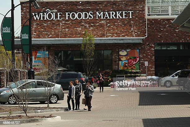 People walk out of Whole Foods Market in the Brooklyn borough on May 7 2014 in New York City Whole Foods Market an upscale grocery store that sells...