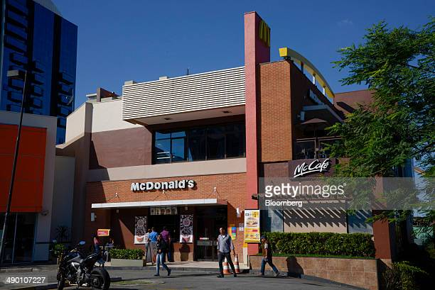 People walk outside a McDonald's Corp restaurant in Barueri Brazil on Tuesday April 29 2014 After being sued by employees in Brazil who rejected its...