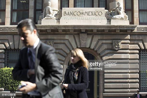 People walk outside Mexico's central bank headquarters the Banco de Mexico in Mexico City Mexico on Tuesday March 15 2016 Mexico is scheduled to...