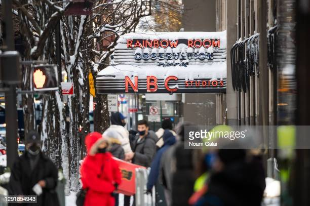 People walk outside NBC Studios during a snow storm on December 17, 2020 in New York City. The pandemic has caused long-term repercussions throughout...