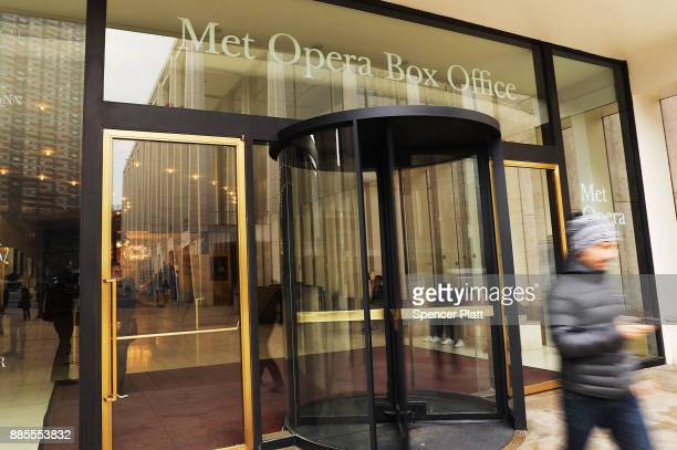 People walk outside of New York's Metropolitan Opera on December 4, 2017 in New York City. In another shock to the entertainment and arts world,...