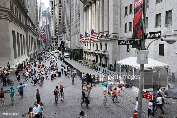 people walk outside of the New York Stock Exchange on August 26 2016 in New York City Stocks fell on Friday after news that the US economy grew at...
