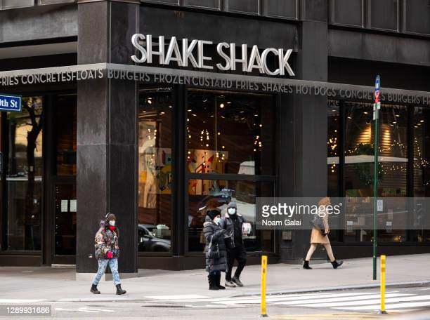 People walk outside Shake Shack in Murray Hill as the city continues the re-opening efforts following restrictions imposed to slow the spread of...