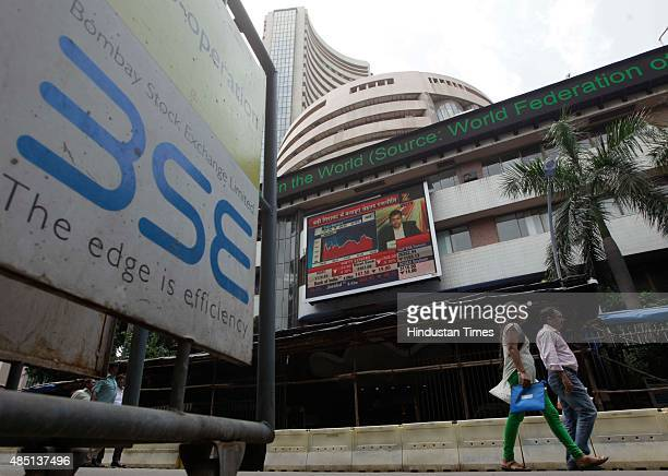 People walk outside the Bombay Stock Exchange on August 24 2015 in Mumbai India Sensex crashed over 1700 points or 622 per cent in preclose trade...