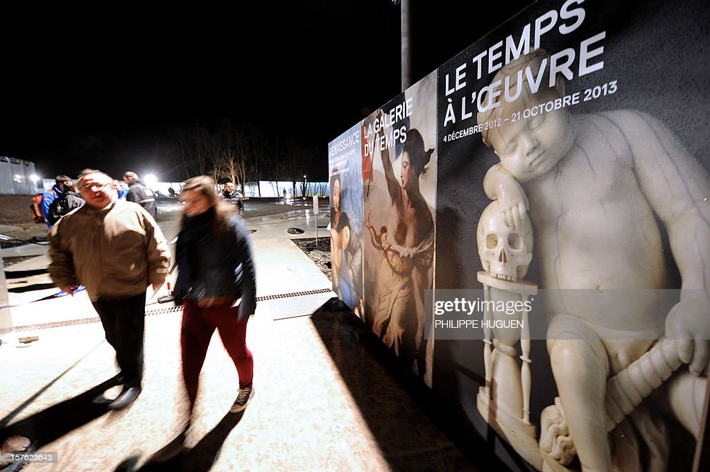 People walk outside the Louvre Museum on the first day of its opening to the public, on December 4, 2012 in Lens, northern France. The Louvre museum opened a new satellite branch among the slag heaps of a former mining town Tuesday in a bid to bring high culture and visitors to one of France's poorest areas. Greeted by a group of former miners in overalls and hardhats, President Francois Hollande inaugurated today the Japanese-designed glass and polished-aluminium branch of the Louvre in the northern city of Lens. The 150 million euro ($196 million) project was 60 percent financed by regional authorities in the Nord-Pas-De-Calais region, on the English Channel and the border with Belgium.