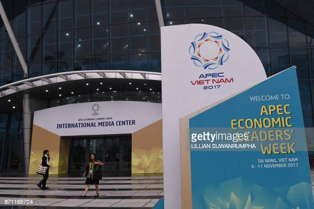 People walk outside the media centre ahead of the AsiaPacific Economic Cooperation Summit in the central Vietnamese city of Danang on November 7 2017...