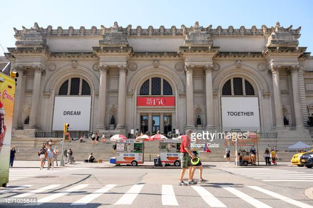 People walk outside The Metropolitan Museum of Art as the city continues Phase 4 of reopening following restrictions imposed to slow the spread of...
