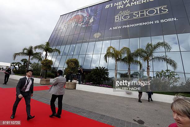 People walk outside the MIPTV one of the world's largest TV and digital content market on April 04 2016 in Cannes southeastern France / AFP / VALERY...
