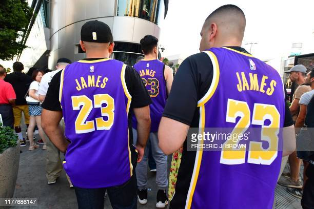 People walk outside the Staples center ahead of the Lakers vs Clippers NBA season opener in Los Angeles on October 22 2019 Activists plan to hand out...