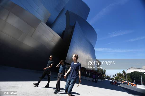 People walk outside the Walt Disney Concert Hall, designed by Frank Gehry, on April 25, 2019 in Los Angeles, California, According to a Bloomberg...