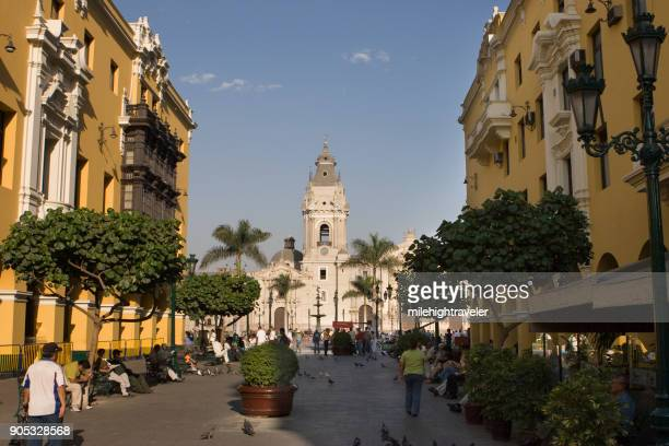 people walk pasaje santa rosa plaza de armas and cathedral of lima peru - lima animal stock pictures, royalty-free photos & images