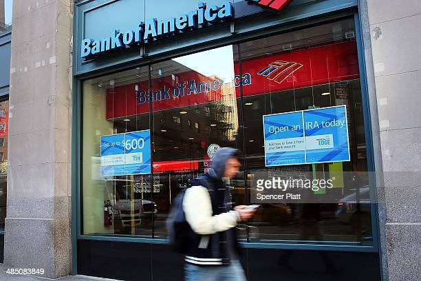 People walk past a Bank of America branch on April 16 2014 in New York City As the nation's secondlargest bank continues to struggle with fallout...