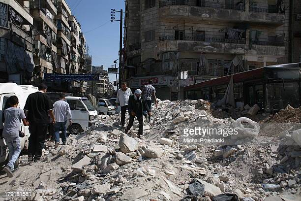 CONTENT] People walk past a barricade preventing regime snipers to hit on pedestrians July 2013 Aleppo Syria Karaj alHajez crossing Aleppo alley of...