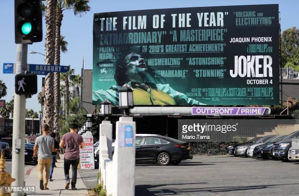 People walk past a billboard displayed for the new film 'Joker' on October 3 2019 in West Hollywood California Security measures have been tightened...