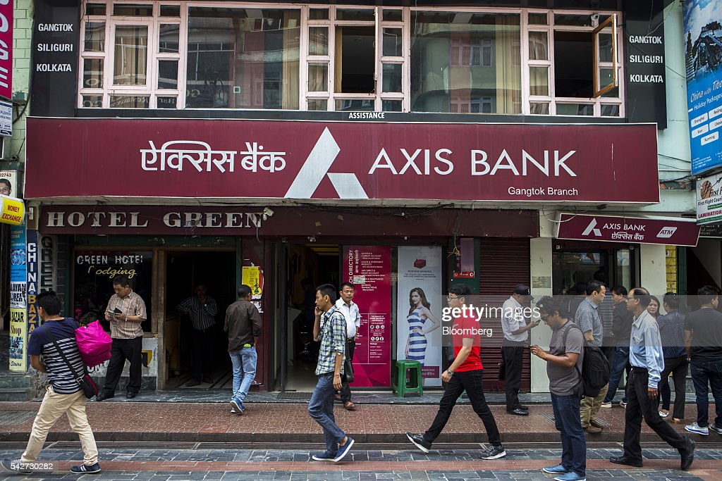 People walk past a branch of Axis Bank Ltd. on Mahatma Gandhi Road in Gangtok, India, on Tuesday, May 3, 2016. Year-on-year growth in Asia's third-largest economy accelerated in the first three months of 2016 to 7.9 percent. Photographer: Prashanth Vishwanathan/Bloomberg via Getty Images