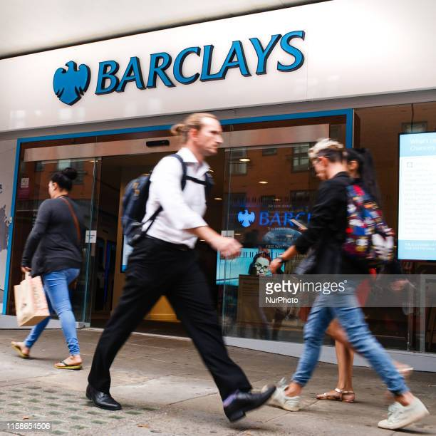 People walk past a branch of Barclays bank on High Holborn in London, England, on July 26, 2019. Four major UK banks, including Barclays, are set to...